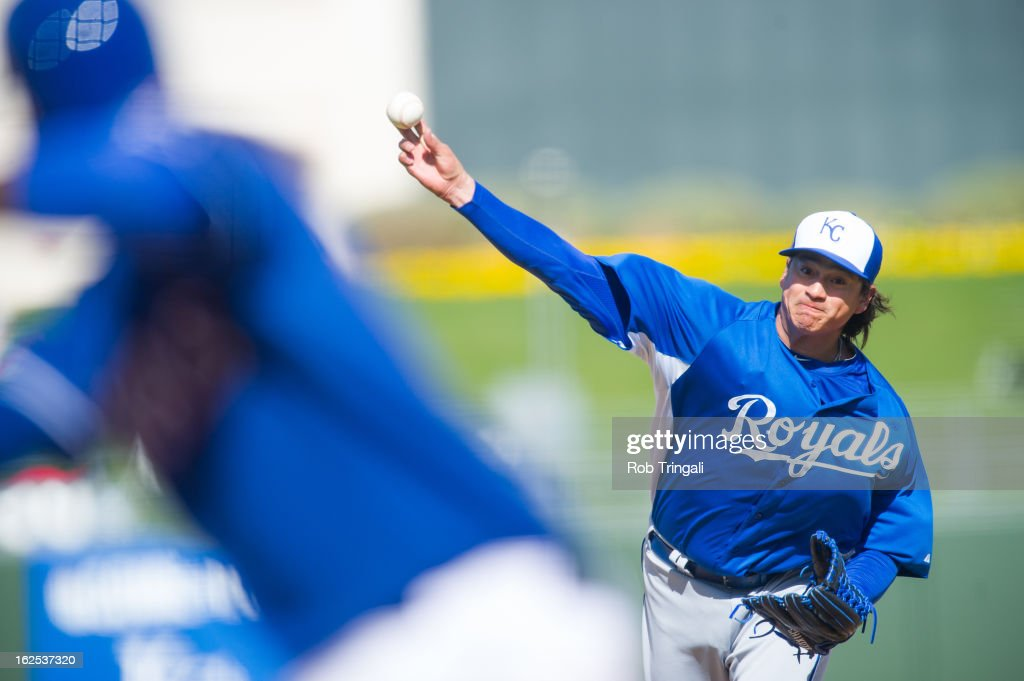 Luis Mendoza of the Kansas City Royals pitches against the Texas Rangers at Surprise Stadium on February 24 2013 in Surprise Arizona