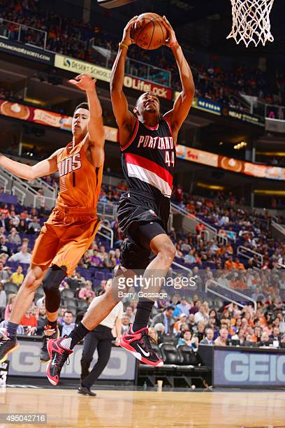 Luis Montero of the Portland Trail Blazers goes for the layup against Devin Booker of the Phoenix Suns on October 30 2015 at Toyota Center in Houston...