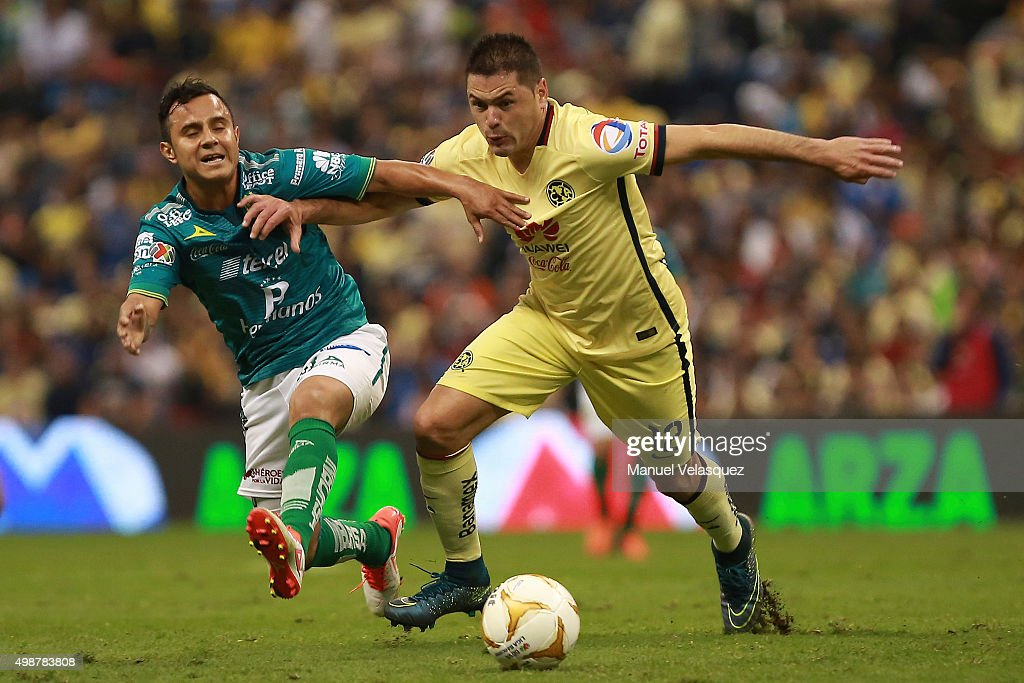 Luis Montes of Leon struggles for the ball with Pablo Aguilar of America during the quarterfinals first leg match between America and Leon as part of...