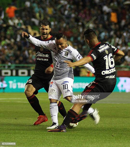 Luis Montes of Leon vies for the ball with Guido Rodriguez and Michael Orozco of Tijuana during the first leg Mexican Apertura 2016 Tournament...