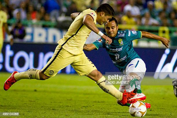 Luis Montes of Leon vies for the ball with Javier Guemez of America during their Mexican Apertura tournament football match at the Nou Camp stadium...
