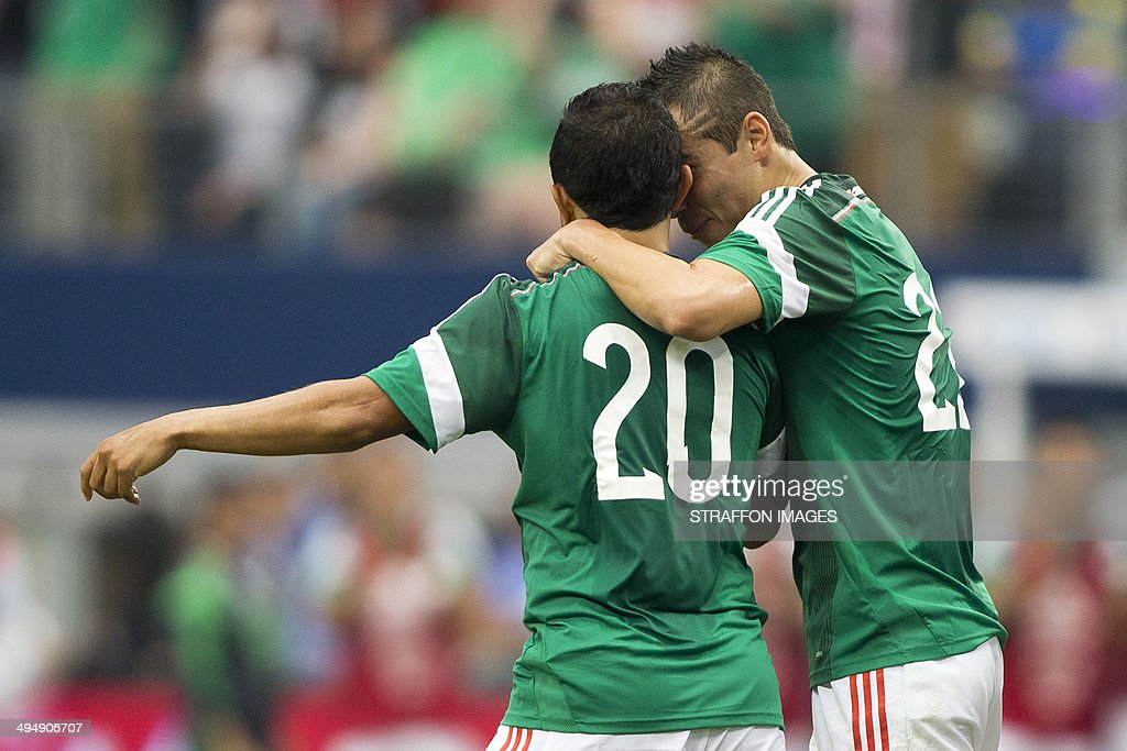 Luis Montes of Mexico (L) celebrates with his team mate a <a gi-track='captionPersonalityLinkClicked' href=/galleries/search?phrase=Paul+Aguilar&family=editorial&specificpeople=4476672 ng-click='$event.stopPropagation()'>Paul Aguilar</a> (R) a scored goal during the International Friendly match between Mexico and Ecuador at AT&T Stadium on May 31, 2014 in Arlington, United States.