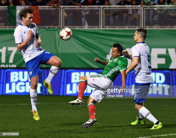 Luis Montes of Mexico kicks the ball up the field under pressure from David Thor Vidarsson and Hallgrimur Jonasson of Iceland during their exhibition...