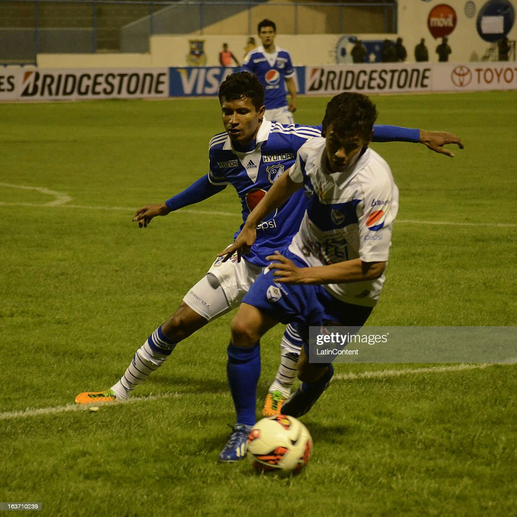 Luis Mosquera of Millonarios struggles for the ball with Marcelo Gomez of San Jose during a match between Millonarios and San Jose as part of Copa Bridgestone Libertadores 2013 at Jesús Bermúdez Stadium on March 14, 2013 in San Jose de Oruro, Bolivia.