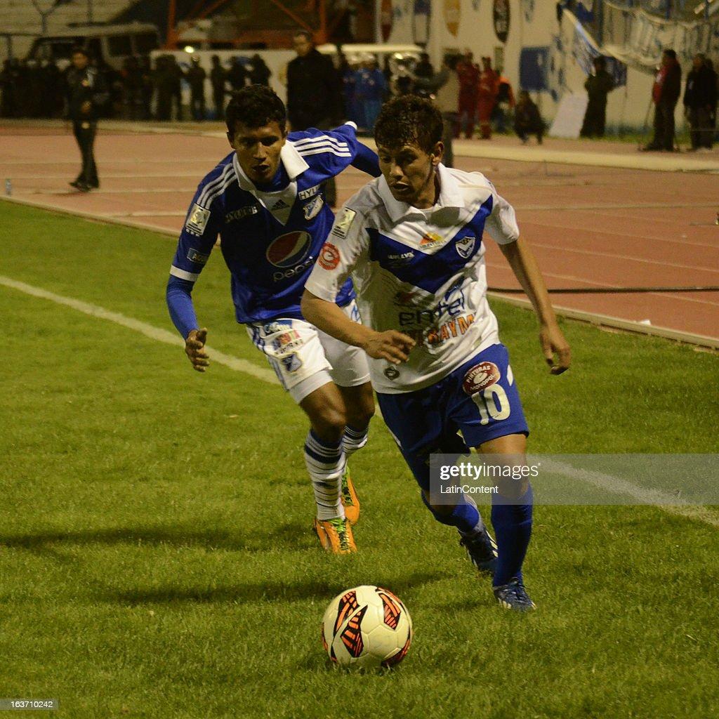 Luis Mosquera of Millonarios struggles for the ball with Marcelo Gomez of San Jose during a match between Millonarios and San Jose as part of Copa Bridgestone Libertadores 2013 at Jesús Bermúdez Stadium on March 14, 2013 in San Jose de Oruro, Bolivia.