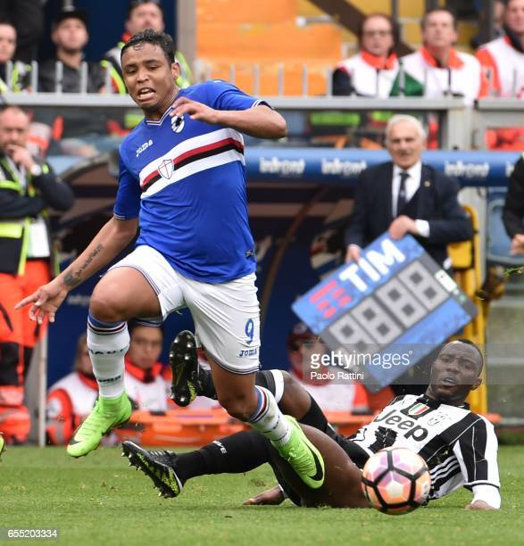 Luis Muriel and Kwadwo Asamoah during the Serie A match between UC Sampdoria and Juventus FC at Stadio Luigi Ferraris on March 19 2017 in Genoa Italy