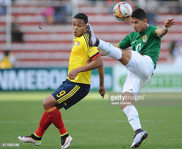 Luis Muriel of Colombia and Marvin Bejarano of Bolivia fight for the ball during a match between Bolivia and Colombia as part of FIFA 2018 World Cup...