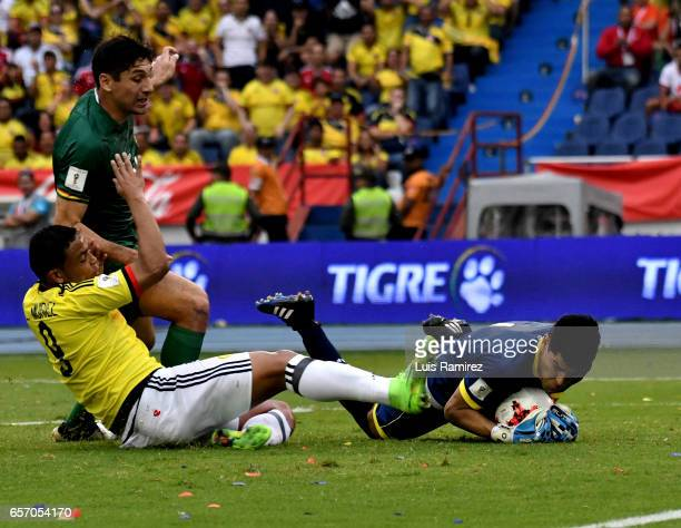 Luis Muriel of Colombia vies for the ball with Carlos Lampe goalkeeper of Bolivia during a match between Colombia and Bolivia as part of FIFA 2018...