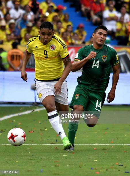 Luis Muriel of Colombia vies for the ball with Juan Aponte of Bolivia during a match between Colombia and Bolivia as part of FIFA 2018 World Cup...