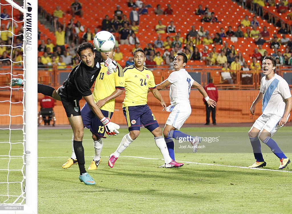 Luis Muriel #24 of Colombia watches as the ball he headed goes past goalkeeper Ricardo Jerez, Jr. #1 of Guatemala on February 6, 2013 at SunLife Stadium Stadium in Miami Gardens, Florida. Colombia defeated Guatemala 4-1.