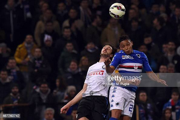 Luis Muriel of Sampdoria and Andrea Ranocchia of Internazionale Milano compete for a header during the Serie A match between UC Sampdoria and FC...