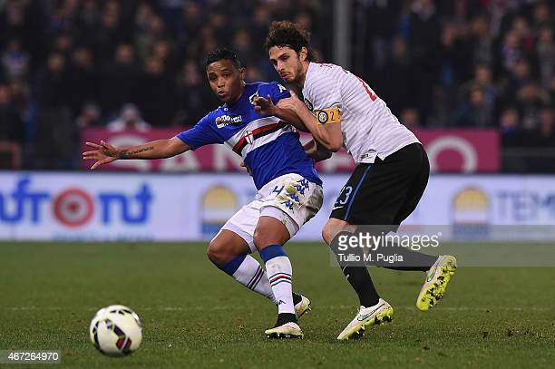 Luis Muriel of Sampdoria and Andrea Ranocchia of Internazionale Milano compete for the ball during the Serie A match between UC Sampdoria and FC...
