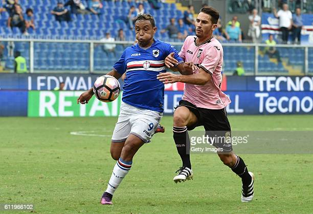 Luis Muriel of Sampdoria is challenged by Edoardo Goldaniga of Palermo during the Serie A match between UC Sampdoria and US Citta di Palermo at...