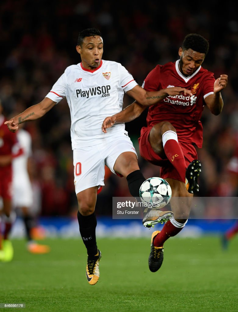 Luis Muriel of Sevilla and Joe Gomez of Liverpool battle for possession during the UEFA Champions League group E match between Liverpool FC and Sevilla FC at Anfield on September 13, 2017 in Liverpool, United Kingdom.