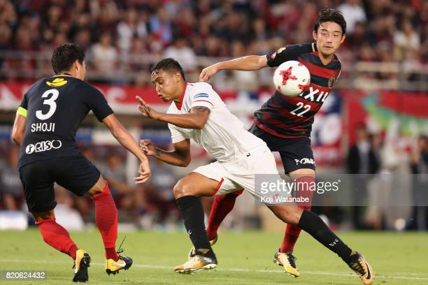 Luis Muriel of Sevilla competes for the ball against Gen Shoji and Daigo Nishi of Kashima Antlers during the preseason friendly match between Kashima...