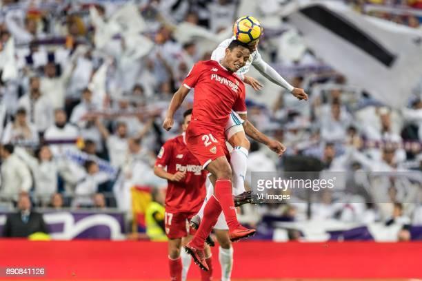 Luis Muriel of Sevilla FC Marcos Llorente of Real Madrid during the La Liga Santander match between Real Madrid CF and Sevilla FC on December 09 2017...