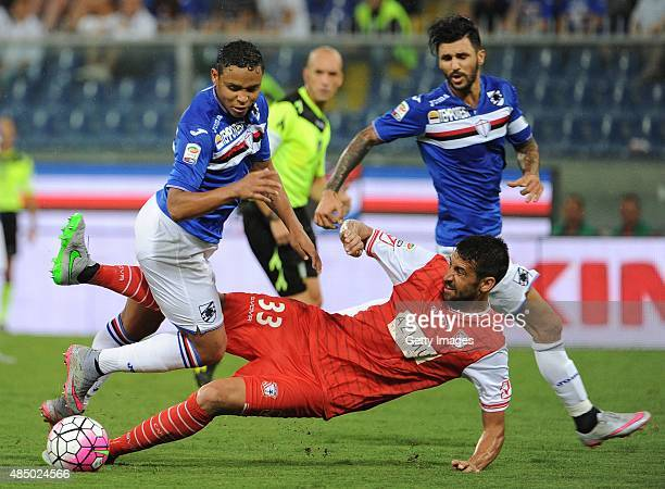Luis Muriel of UC Sampdoria compete for the ball with Nicolas Spolli of Carpi FC during the Serie A match between UC Sampdoria and Carpi FC at Stadio...