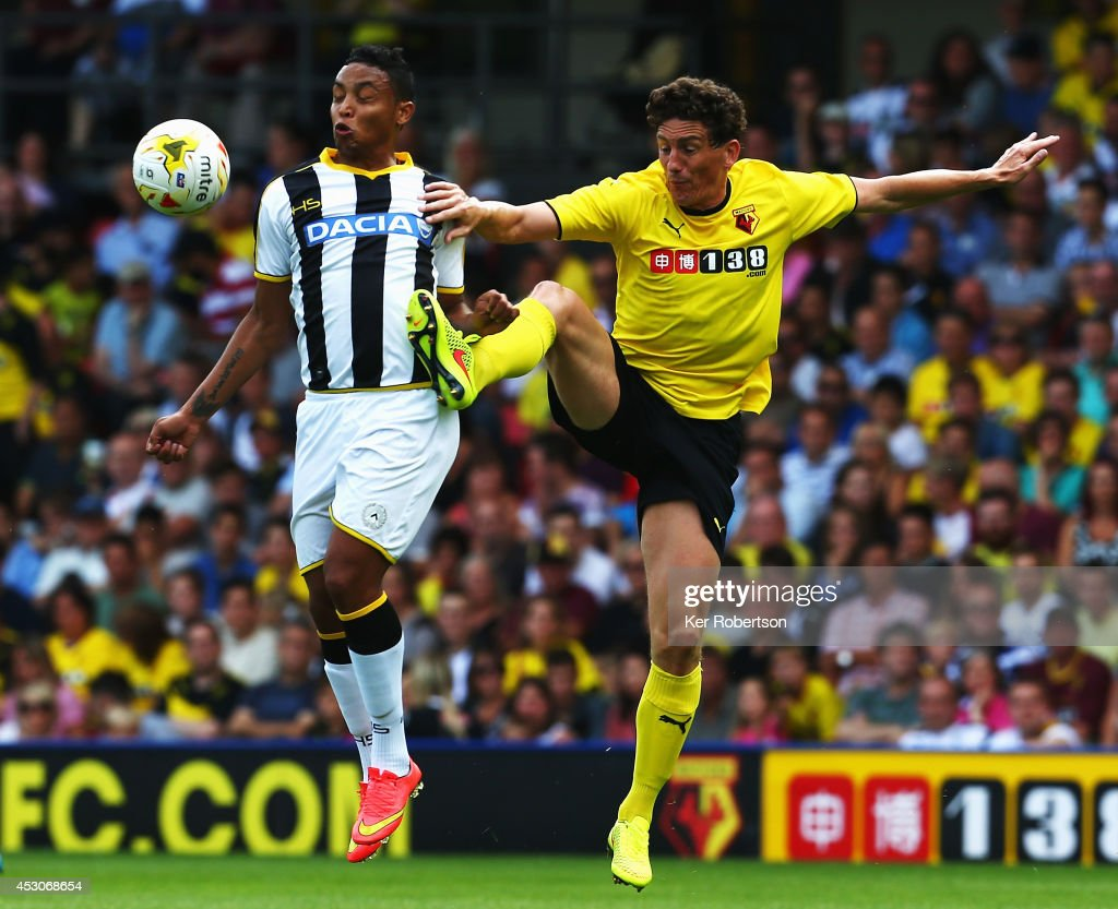 <a gi-track='captionPersonalityLinkClicked' href=/galleries/search?phrase=Luis+Muriel&family=editorial&specificpeople=8007067 ng-click='$event.stopPropagation()'>Luis Muriel</a> of Udinese and <a gi-track='captionPersonalityLinkClicked' href=/galleries/search?phrase=Keith+Andrews&family=editorial&specificpeople=661603 ng-click='$event.stopPropagation()'>Keith Andrews</a> of Watford challenge for the ball during the pre-season friendly between Watford and Udinese at Vicarage Road on August 2, 2014 in Watford, England.