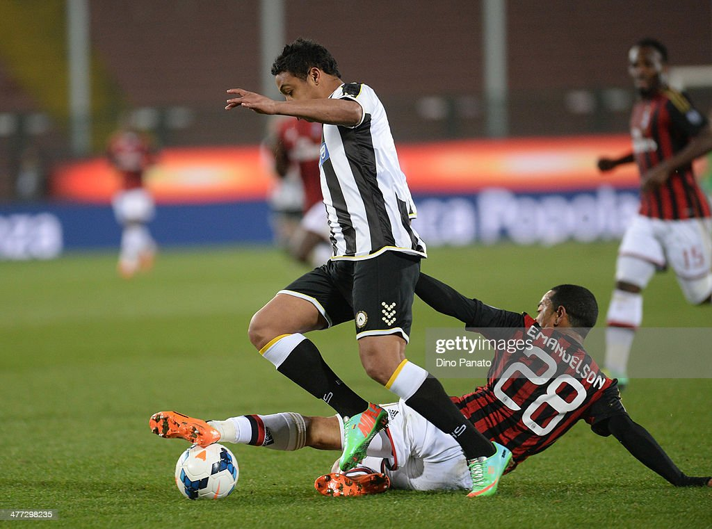 Luis Muriel of Udinese Calcio is takled to Urby Emanuelson of AC Milan during the Serie A match between Udinese Calcio and AC Milan at Stadio Friuli on March 8, 2014 in Udine, Italy.