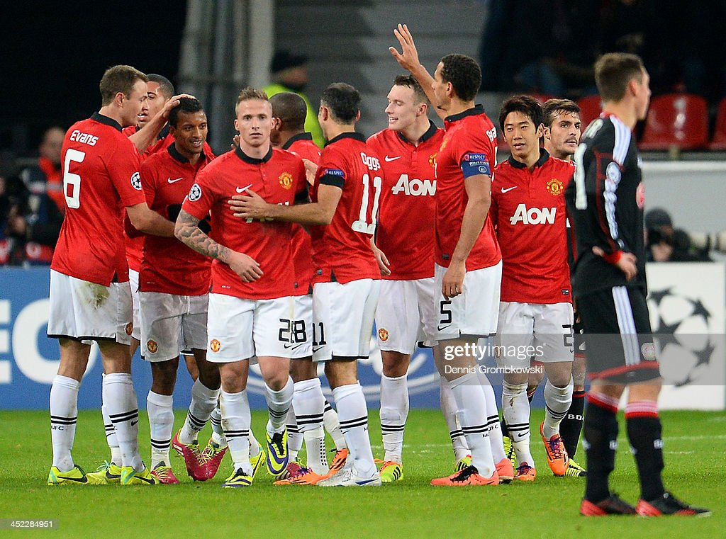 Luis Nani of Manchester United celebrates with team mates after scoring the fifth goal during the UEFA Champions League Group A match between Bayer Leverkusen and Manchester United at BayArena on November 27, 2013 in Leverkusen, Germany.
