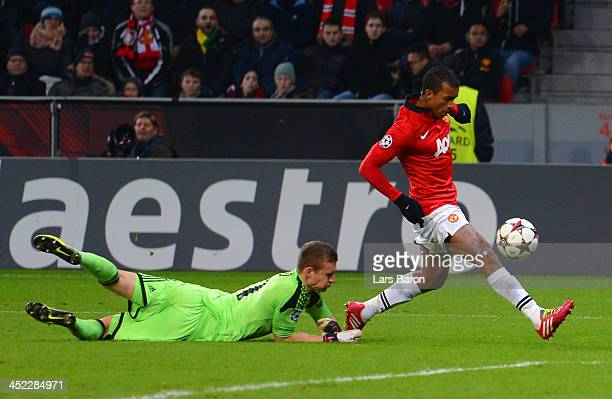 Luis Nani of Manchester United rounds Bernd Leno of Bayer Leverkusen to score their fifth goal during the UEFA Champions League Group A match between...