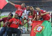 Luis Nani of Portugal and his family pose with the trophy following the UEFA Euro 2016 final match between Portugal and France at Stade de France on...