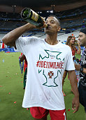 Luis Nani of Portugal celebrates with champagne the victory following the UEFA Euro 2016 final match between Portugal and France at Stade de France...