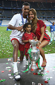 Luis Nani of Portugal his wife Daniela Martins and their son pose with the trophy following the UEFA Euro 2016 final match between Portugal and...
