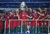 Luis Nani of Portugal holds the trophy during the trophy ceremony following the UEFA Euro 2016 final match between Portugal and France at Stade de...