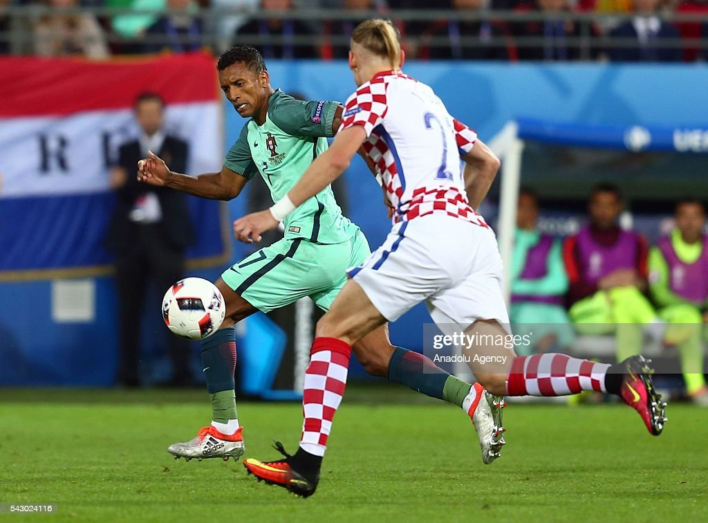 Luis Nani (L) of Portugal in action during the Euro 2016 round of 16 football match between Croatia and Portugal at Stade Bollaert-Delelis in Lens, France on June 25, 2016.