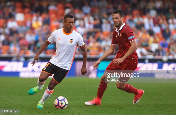 Luis Nani of Valencia CF and Franco Vazquez of Sevilla FC during their La Liga match between Valencia CF and Sevilla FC at the Mestalla Stadium on...