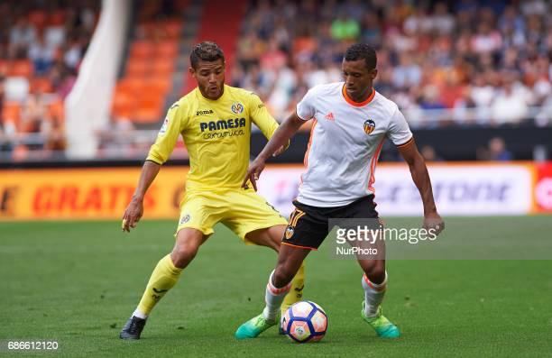 Luis Nani of Valencia CF and Jonathan Dos Santos of Villarreal CF during their La Liga match between Valencia CF and Villarreal CF at the Mestalla...