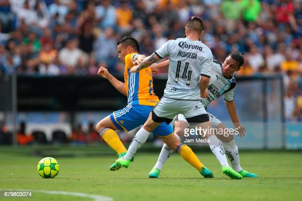 Luis Noriega and Angel Sepulveda of Queretaro fight for the ball with Lucas Zelarayan of Tigres during a match between Queretaro against Tigres as...
