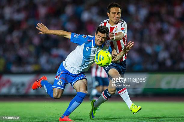 Luis Noriega of Puebla fights for the ball with Erick Torres of Chivas during a Championship match between Puebla and Chivas as part of Copa MX...