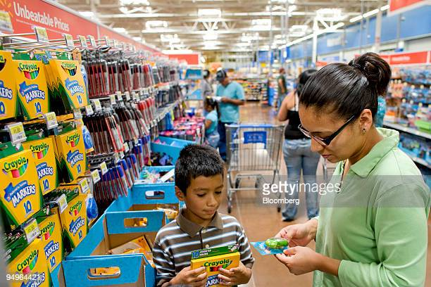 Luis Orosco who is starting 4th grade shops for school supplies with his mom Guadalupe Orosco at a WalMart store in Thornton Colorado US on Saturday...