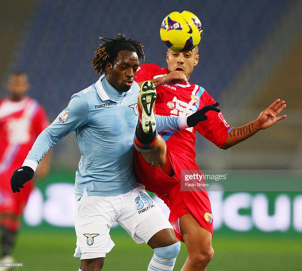 Luis Pedro Cavanda (L) of S.S. Lazio competes for the ball with Sergio Almiron of Calcio Catania during the TIM Cup match between S.S. Lazio and Calcio Catania at Stadio Olimpico on January 8, 2013 in Rome, Italy.