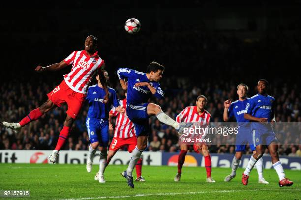 Luis Perea of Atletico Madrid scores an own goal during the UEFA Champions League Group D match between Chelsea and Atletico Madrid at Stamford...