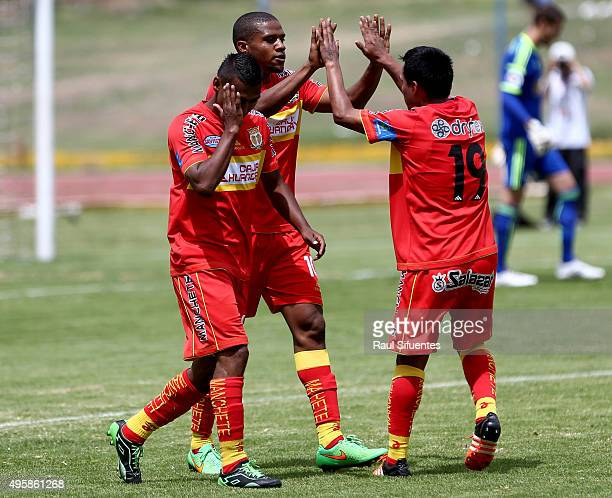 Luis Perea of Sport Huancayo celebrates with his teammates after scoring the first goal of his team by a penalty kick during a match between Sport...