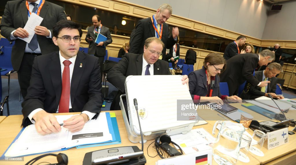 Luis Pereira (L), Portugal's Secretary of State for Foreign Affairs and Cooperation, <a gi-track='captionPersonalityLinkClicked' href=/galleries/search?phrase=Dirk+Niebel&family=editorial&specificpeople=710721 ng-click='$event.stopPropagation()'>Dirk Niebel</a>, German Federal Minister of Economic Cooperation and Development, and Heidi Hautala (R), Finland's Minister for International Development attend the Informal Meeting of Ministers for Development Cooperation on February 12, 2013 in Dublin Castle, Dublin, Ireland. EU Development Ministers are discussing aid to Mali and efforts to help communities at risk of disaster to better prepare for shocks such as floods or drought. The Ministers and Commissioners are discussing options for a future EU development programme to Mali, in addition to the emergency aid which the EU is providing.
