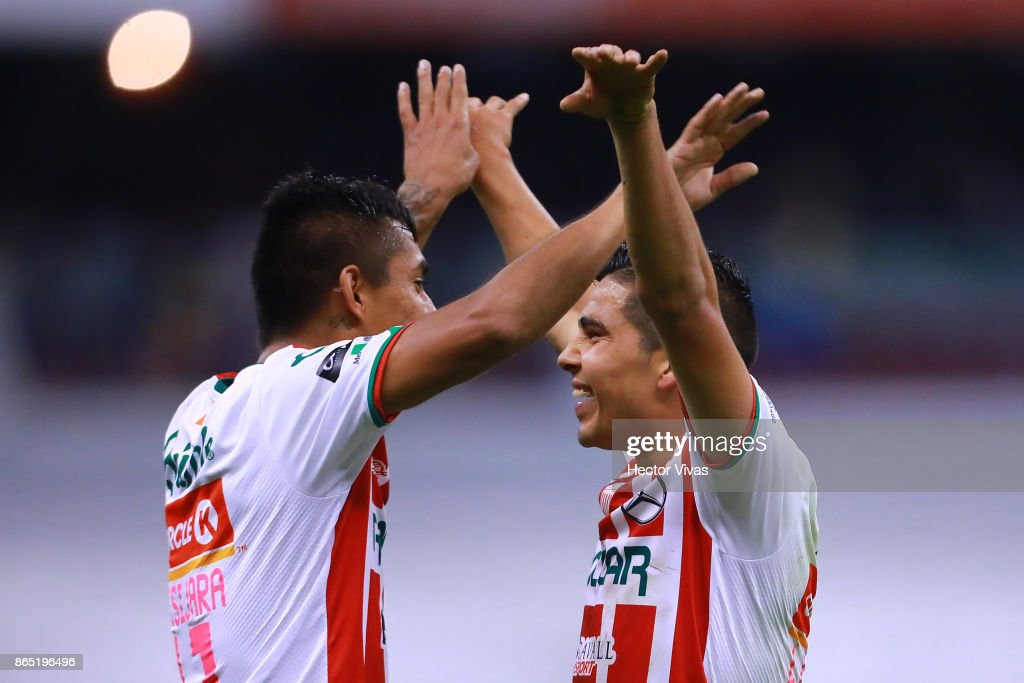 Luis Perez and Jesus Isijara of Necaxa celebrate after winning the 14th round match between America and Necaxa as part of the Torneo Apertura 2017 Liga MX at Azteca Stadium on October 21, 2017 in Mexico City, Mexico.