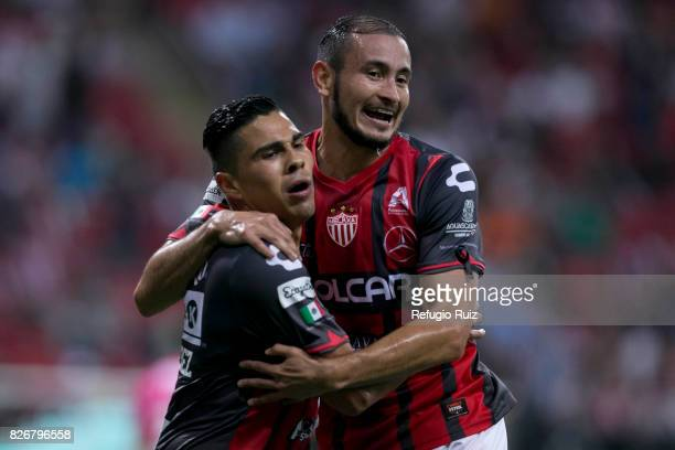 Luis Perez of Necaxa celebrates with Carlos Gonzalez after scoring the second goal of his team during the third round match between Chivas and Necaxa...
