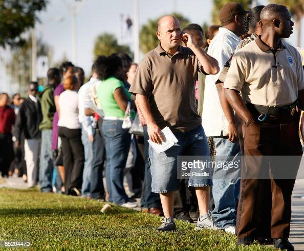 Luis Queones stands in line with hundreds of other people looking for jobs at the Miami Dade College Mega Job Fair 2009 on March 3 2009 in North...