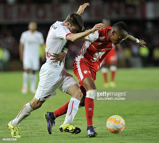 Luis Quinones of Colombias Santa Fe vies for the ball with Nicolas Tagliafico of Argentina's Independiente during their Copa Sudamericana football...