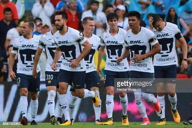 Luis Quintana of Pumas celebrates with teammates after scoring the first goal of his team during the 12th round match between Pumas UNAM and Cruz...