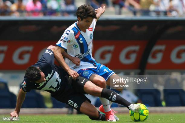 Luis Quintana of Pumas fights for the ball with Carlos Orrantia of Puebla during the 17th round match between Pumas UNAM and Puebla as part of the...