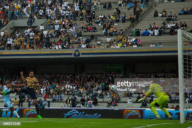 Luis Quintana of Pumas heads the ball to score the first goal of his team during the 16th round match between Pumas UNAM and Queretaro as part of the...