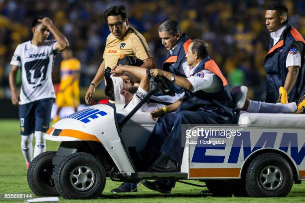 Luis Quintana of Pumas leaves the field after being injured during the 5th round match between Tigres and Pumas as part of the Torneo Apertura 2017...