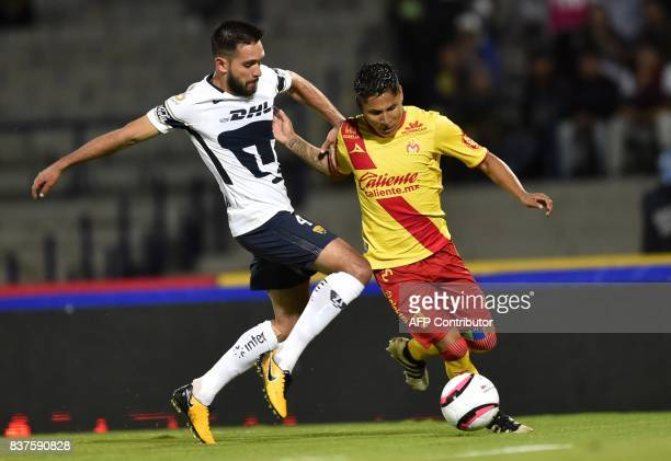 Luis Quintana of Pumas vies for the ball with Raul Ruidiaz of Morelia during their Mexican Apertura tournament football match at the University...