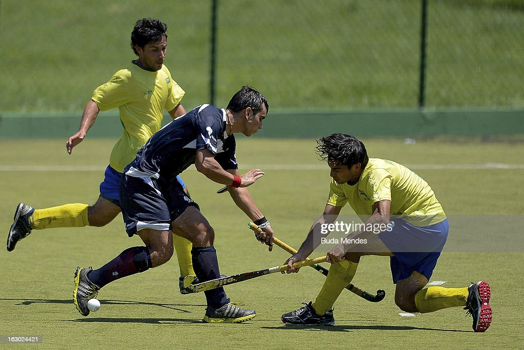 Luis Reus (L) and Yuri Van Der Heijden (R) of Brazil in action during a match between Brazil and Chile as part of the Hockey World League - Round 2 at Complexo Esportivo de Deodoro on March 03, 2013 in Rio de Janeiro, Brazil.