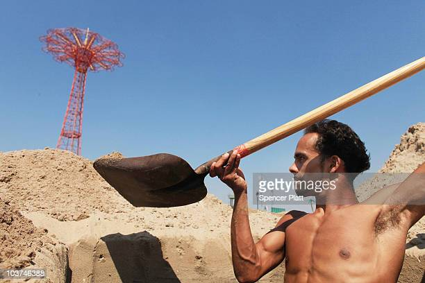 Luis Reyes digs a hole digs a hole at the beach on a hot afternoon at Coney Island on August 31 2010 in the Brooklyn borough of New York City Reyes...
